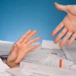 2 hands in paper